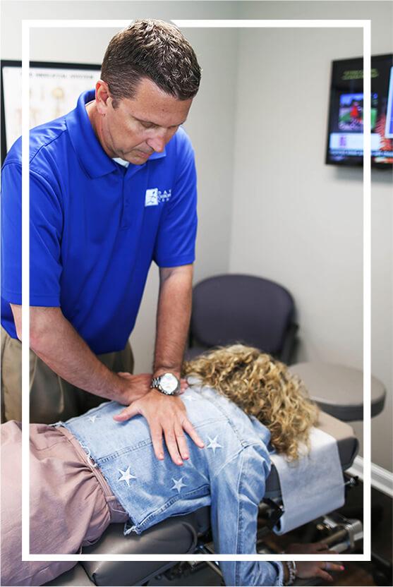 Dr. Davis adjusting patient