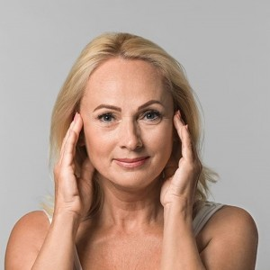 Mature woman stretched face