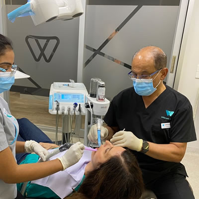 Dentist working on patients mouth