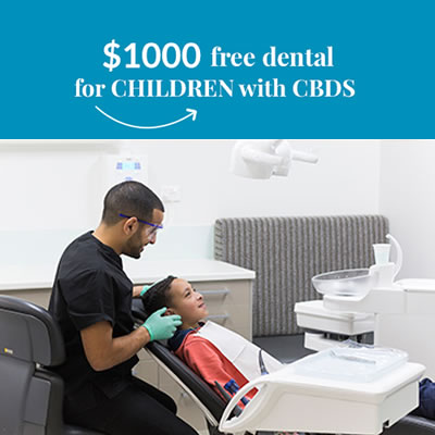 Dentist checking childs mouth