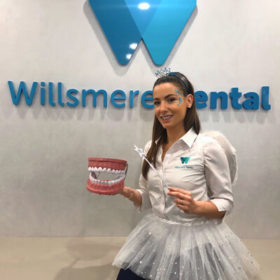 Staff member dressed as tooth fairy
