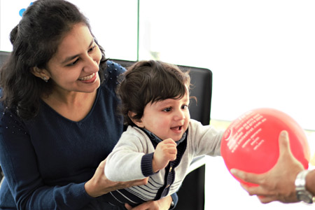 woman-and-baby-red-balloon