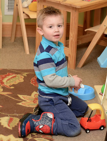 Boy playing with toys at Inner Balance Chiropractic