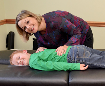 Dr. Alison Cummings with pediatric chiropractic patient.