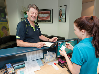 new patient welcomed by receptionist