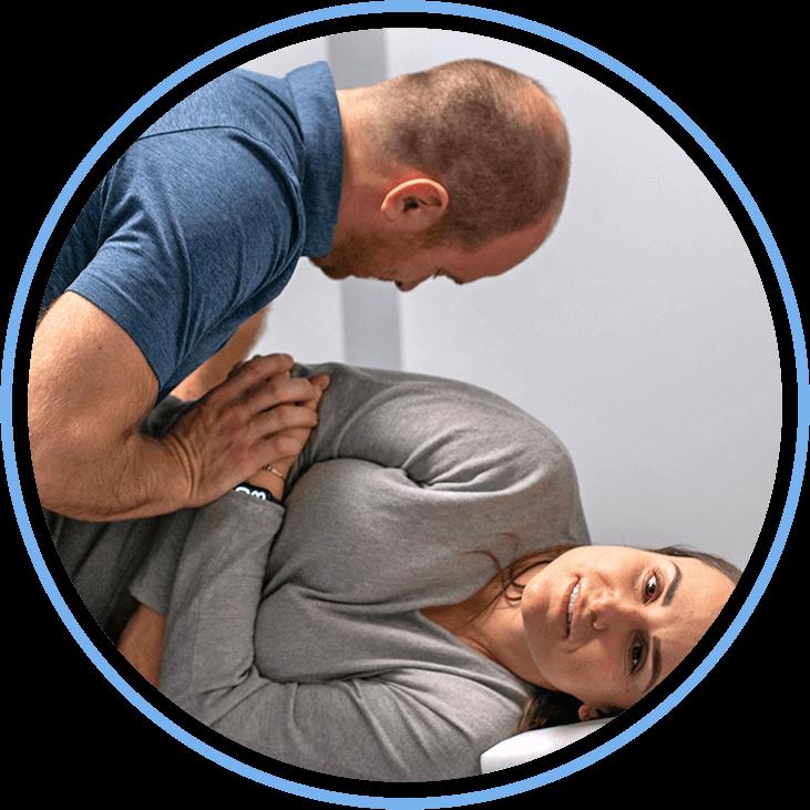 Doctor adjusting patient on side