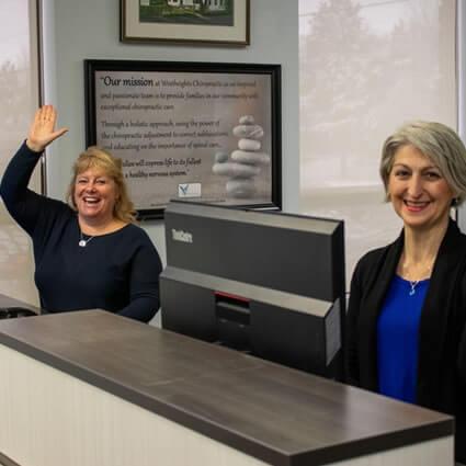 Ladies waiting at reception desk