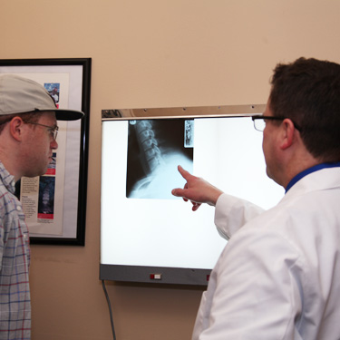 Dr. Smith reviewing xrays with patient