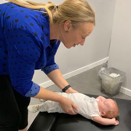 Dr. Beth adjusting baby