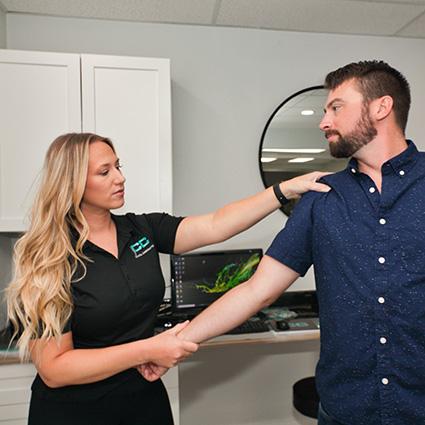 doctor treating shoulder area