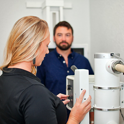 Dr Beth getting motion x-rays from male patient