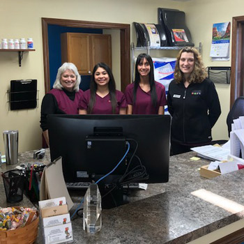 Staff at the front desk of the office