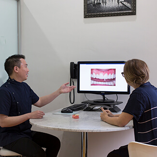 Review of X-rays with Patient at Fine Dentistry