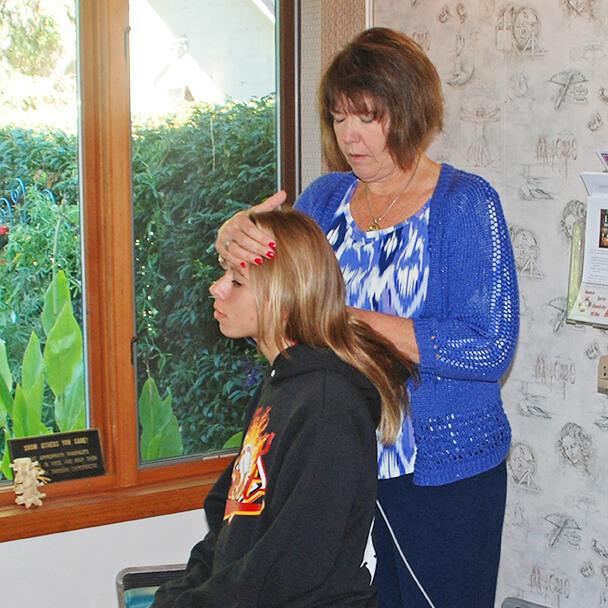 Dr Kim adjusting teen