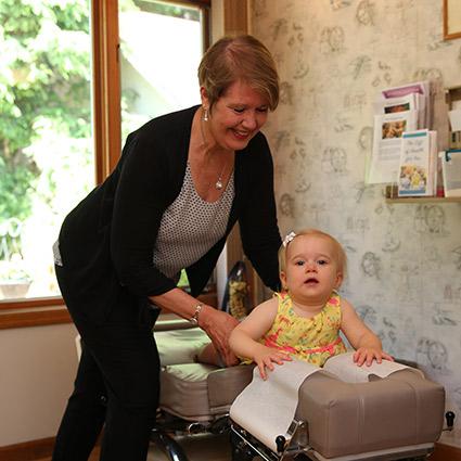 Dr Kim adjusting baby