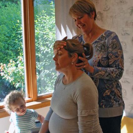 Dr Kim adjusting pregnant woman