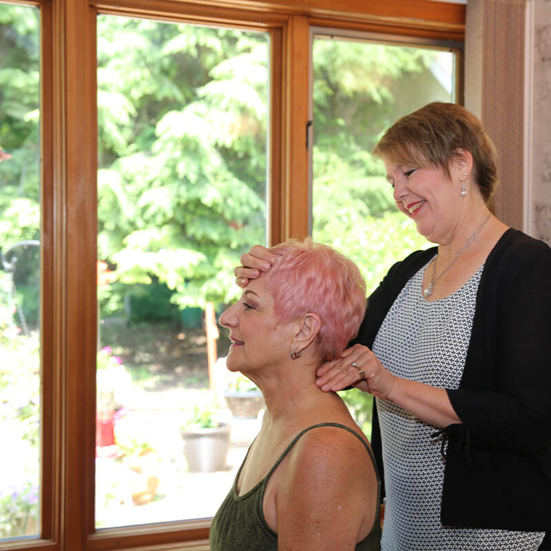 Dr Kim adjusting woman