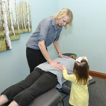 Dr. Amy adjusting