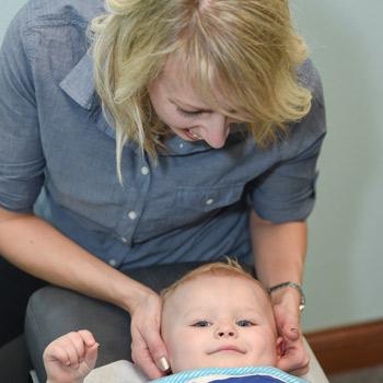 Dr. Amy adjusting baby