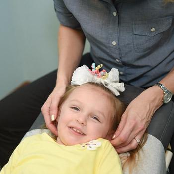 Dr. Amy adjusting Toddler