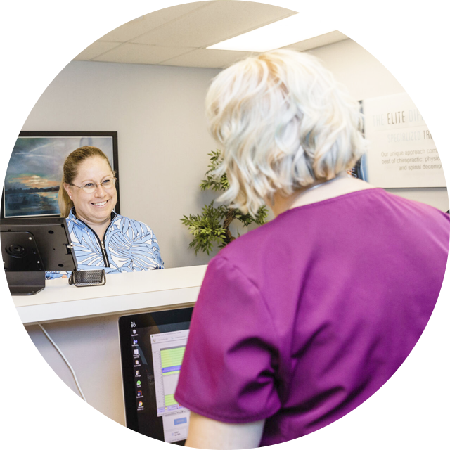 Receptionist smiling at patient