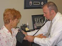 Dr. Ryan checking vital signs.