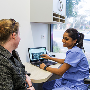 Dr. Anisha reviews xray with patient