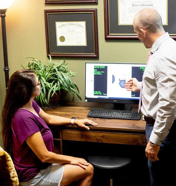 doctor and patient looking at computer screen