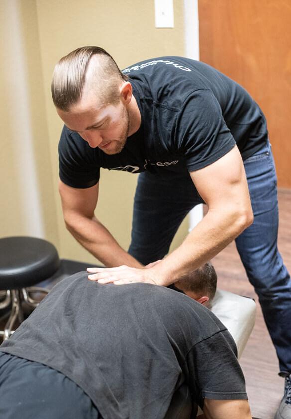 Dr. Noah adjusting shoulder
