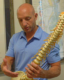 Dr. Himsel uses the spine to talk about chiropractic care.