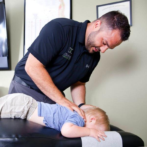 Dr. Dinkel adjusting baby