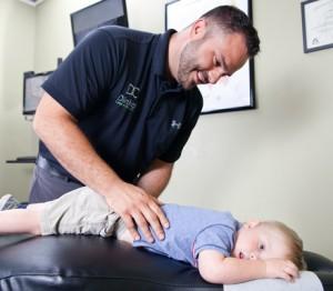 Dr. Dinkel adjusting a child.