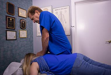 Dr. Brad Adjusting Patient