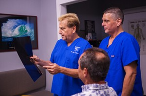 Dr. Brad and Dr. Brian with a patient