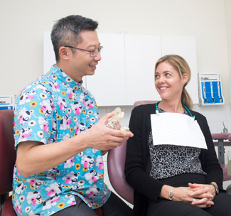 Dentist Elanora, Dr. Lo with new patient