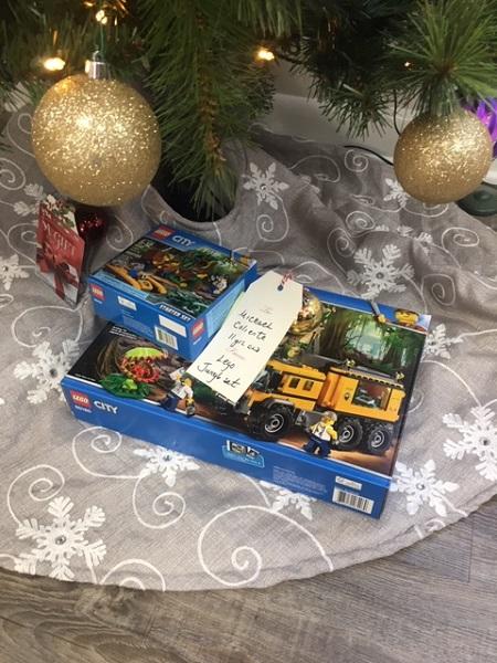 Christmas gift with giving tree tag