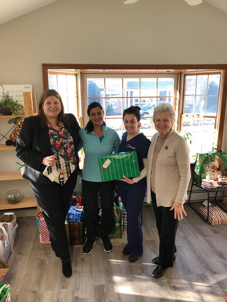 mpfd team with patients and gifts