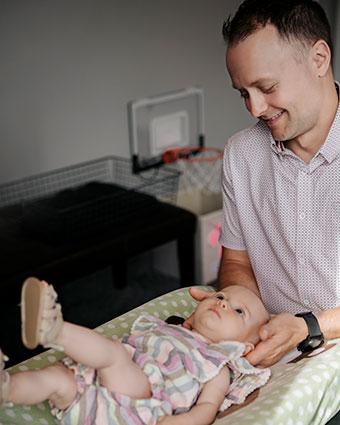 Dr Jami adjusting toddler