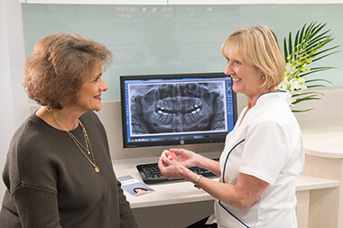 Dr Gillian consulting with patient