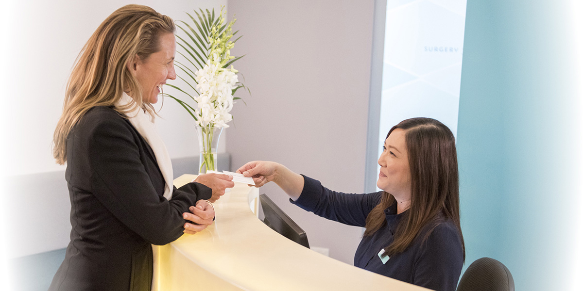 Patient being greeted by receptionist