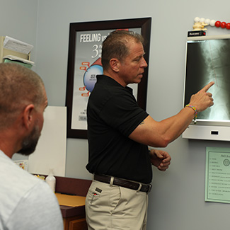 Dr. Ormsby reviewing Xrays with patient