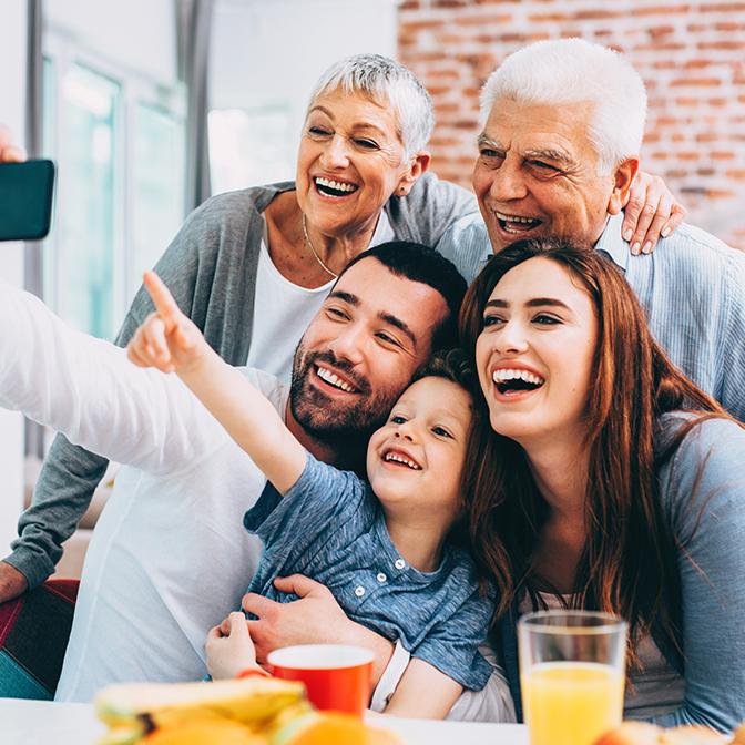 three generation family smiling
