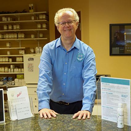 Dr. Whalen at reception desk