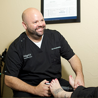 Dr. Kyle smiling at patient