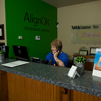Jill on the phone at the front desk
