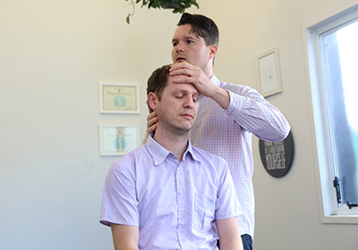 Dr Albrecht adjusting patient