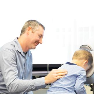 Dr. Mills adjusting small child
