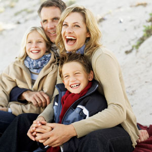 family-smiling-outside-in-fall-sq-300