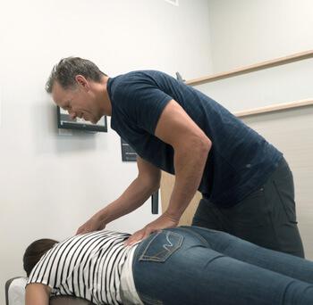 Dr. Gray adjusting woman's lower back