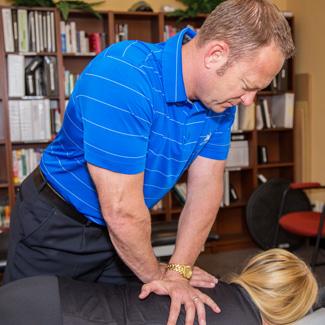 Dr. Ken adjusting patient